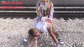 clown fucks girl on train tracks